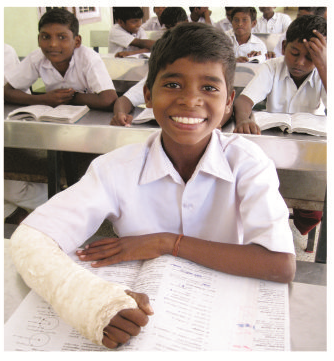 Iyyanar with his broken arm and a wide smile